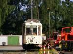 Strasenbahn - Stadtbahn/108718/ein-zweiachsiger-aufbautriebwagen-der-dortmunder-strassenbahn Ein zweiachsiger Aufbautriebwagen der Dortmunder Straßenbahn und weitere Fahrzeuge stehen am 04.07.2010 in einem Verkehrsmuseum am 'Mooskamp' in Dortmund-Nette.